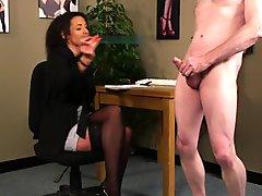 Classy office babe instructing naked guy