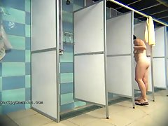 A hidden camera in a public shower films gorgeous women while they soap up their